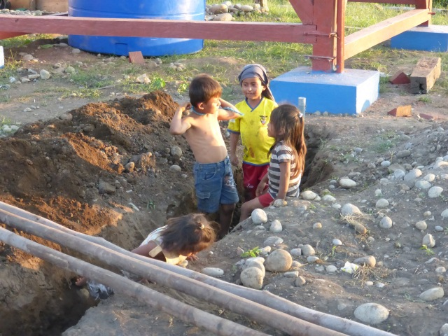 Children playing at the work site